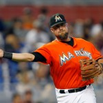 MIAMI, FL - SEPTEMBER 7: Third basemen Casey McGehee #9 of the Miami Marlins fields a ball against the Atlanta Braves in the seventh inning at Marlins Park on September 7, 2014 in Miami, Florida. (Photo by Eliot J. Schechter/Getty Images)