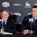MIAMI, FL - NOVEMBER 19:  Giancarlo Stanton of the Miami Marlins speaks as owner Jeffrey Loria looks on during a press conference at Marlins Park on November 19, 2014 in Miami, Florida.  (Photo by Rob Foldy/Getty Images)