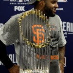 KANSAS CITY, MO - OCTOBER 29:  Pablo Sandoval #48 of the San Francisco Giants stands with The Commissioner's Trophy following a 3-2 victory over the Kansas City Royals in Game Seven of the 2014 World Series at Kauffman Stadium on October 29, 2014 in Kansas City, Missouri.  (Photo by Charlie Niebergall- Pool/Getty Images)