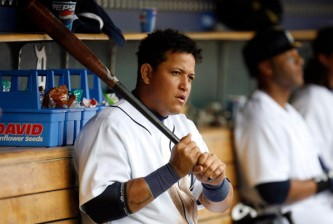 DETROIT - MARCH 31:  Miguel Cabrera #24 of the Detroit Tigers sits in the dugout against the Kansas City Royals during their game on Opening Day on March 31, 2008 at Comerica Park in Detroit, Michigan. Royals won 5-4 in 11 innings.  (Photo by Gregory Shamus/Getty Images)