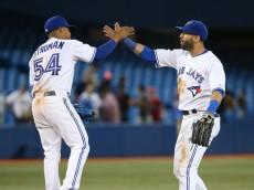 Marcus Stroman and Jose Bautista of the Blue Jays