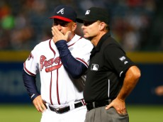 ATLANTA, GA - SEPTEMBER 17:  Fredi Gonzalez #33 of the Atlanta Braves converses with first base umpire Ed Hickox #15 after Christian Bethancourt #25 was called out to end the fourth inning against the Washington Nationals at Turner Field on September 17, 2014 in Atlanta, Georgia.  (Photo by Kevin C. Cox/Getty Images)