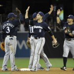 SAN DIEGO, CA - APRIL 23:  Milwaukee Brewers players high-five after beating the San Diego Padres 6-3 in a baseball game at Petco Park on April 23, 2013 in San Diego, California.  (Photo by Denis Poroy/Getty Images)
