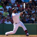 BOSTON, MA - AUGUST 23: Mike Napoli #12 of the Boston Red Sox bats during the third inning against the Seattle Mariners at Fenway Park on August 23, 2014 in Boston, Massachusetts. The Mariners won 7-3. (Photo by Rich Gagnon/Getty Images)