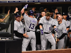 SAN DIEGO, CA - SEPTEMBER 23: Drew Stubbs #13 of the Colorado Rockies is congratulated in the dugout after he hit a solo home run during the eighth inning of a baseball game against the San Diego Padres at Petco Park September, 23, 2014 in San Diego, California. (Photo by Denis Poroy/Getty Images)