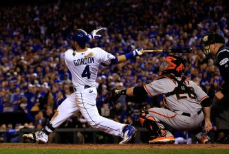 KANSAS CITY, MO - OCTOBER 29:  Alex Gordon #4 of the Kansas City Royals gets a hits in the ninth inning against the San Francisco Giants during Game Seven of the 2014 World Series at Kauffman Stadium on October 29, 2014 in Kansas City, Missouri.  (Photo by Ezra Shaw/Getty Images)