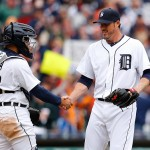DETROIT, MI - APRIL 6: Alex Avila #13 of the Detroit Tigers and Joe Nathan #36 celebrate a win over the Minnesota Twins on Opening Day at Comerica Park on April 6, 2015 in Detroit, Michigan. The Tigers defeated the Twins 4-0. (Photo by Leon Halip/Getty Images)