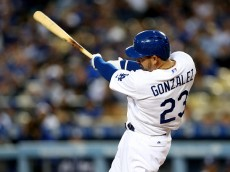 LOS ANGELES, CA - APRIL 08:  Adrian Gonzalez #23 of the Los Angeles Dodgers hits a solo home run in the first inning against the San Diego Padres at Dodger Stadium on April 8, 2015 in Los Angeles, California.  (Photo by Stephen Dunn/Getty Images)