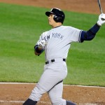 WASHINGTON, DC - APRIL 15:  Alex Rodriguez #42 of the New York Yankees hits a solo home run in the fourth inning on Jackie Robinson Day during a baseball game against the Baltimore Orioles at Orioles Park at Camden Yards on April 15, 2015 in Baltimore, Maryland.  (Photo by Mitchell Layton/Getty Images)