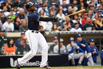 SAN DIEGO, CA - APRIL  25:  Justin Upton #10 of the San Diego Padres hits a two-run home run during the first inning of a baseball game against the Los Angeles Dodgers at Petco Park April 25,  2015 in San Diego, California.   (Photo by Denis Poroy/Getty Images)
