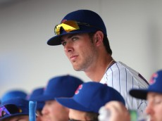 MESA, AZ - FEBRUARY 27:  Kris Bryant #77 of the Chicago Cubs watches from the dugout during the spring training game against the Arizona Diamondbacks at Cubs Park on February 27, 2014 in Mesa, Arizona  (Photo by Christian Petersen/Getty Images)