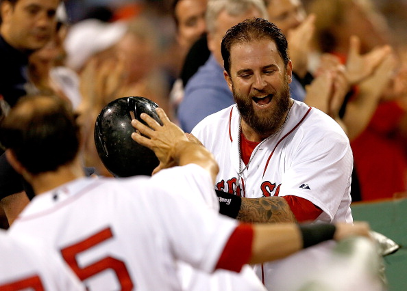 BOSTON, MA - JULY 19:  Mike Napoli #12 of the Boston Red Sox reacts after he connected for a home run in the sixth inning against the Kansas City Royals at Fenway Park on July 19, 2014 in Boston, Massachusetts.  (Photo by Jim Rogash/Getty Images)