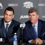 MIAMI, FL - NOVEMBER 19: Miami Marlins Vice President & General Manager Dan Jennings speaks as Giancarlo Stanton looks on during a press conference at Marlins Park on November 19, 2014 in Miami, Florida.  (Photo by Rob Foldy/Getty Images)