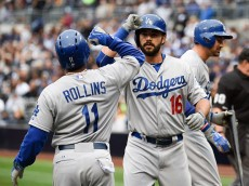 SAN DIEGO, CA - APRIL  25:  Andre Ethier #16 of the Los Angeles Dodgers, right, is congratulated by Jimmy Rollins #11 after hitting a two-run home run during the first inning of a baseball game against the San Diego Padres at Petco Park April 25,  2015 in San Diego, California.   (Photo by Denis Poroy/Getty Images)