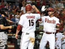 PHOENIX, AZ - APRIL 28:  David Peralta #6 of the Arizona Diamondbacks celebrates with teammate Mark Trumbo #15 after hitting a two-run home run during the fourth inning against the Colorado Rockies at Chase Field on April 28, 2015 in Phoenix, Arizona.  (Photo by Norm Hall/Getty Images)