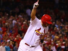 ST. LOUIS, MO - MAY 1: Matt Adams #32 of the St. Louis Cardinals celebrates after hitting a walk-off single against the Pittsburgh Pirates in the tenth inning at Busch Stadium on May 1, 2015 in St. Louis, Missouri.  (Photo by Dilip Vishwanat/Getty Images)