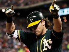 ARLINGTON, TX - MAY 2: Josh Reddick #22 of the Oakland Athletics points to the stands after hitting a three-run home run during the seventh inning of a baseball game against the Texas Rangers at Globe Life Park on May 2, 2015 in Arlington, Texas. (Photo by Brandon Wade/Getty Images)