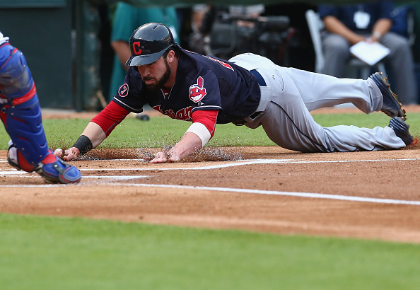 ARLINGTON, TX - MAY 15:  Jason Kipnis #22 of the Cleveland Indians scores a run against the Texas Rangers in the first inning at Globe Life Park in Arlington on May 15, 2015 in Arlington, Texas.  (Photo by Ronald Martinez/Getty Images)