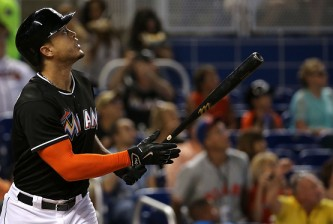 MIAMI, FL - MAY 16:  Giancarlo Stanton #27 of the Miami Marlins hits during a game against the Atlanta Braves at Marlins Park on May 16, 2015 in Miami, Florida.  (Photo by Mike Ehrmann/Getty Images)
