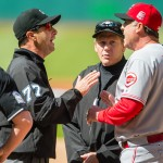 CLEVELAND, OH -  MAY 23: Umpire Jim Reynolds #77 argues with manager Bryan Price #38 of the Cincinnati Reds just prior to Reynolds ejecting Price prior to the game against the Cleveland Indians at Progressive Field on May 23, 2015 in Cleveland, Ohio. (Photo by Jason Miller/Getty Images)