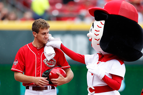 CINCINNATI, OH - MAY 25: Cincinnati Reds mascot Rosie Red wipes rain from the face of a ball boy during a brief shower prior to the game against the Colorado Rockies at Great American Ball Park on May 25, 2015 in Cincinnati, Ohio. (Photo by Joe Robbins/Getty Images)
