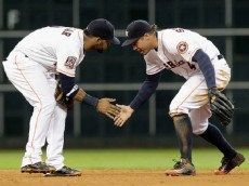 HOUSTON, TX - MAY 19:  George Springer #4 of the Houston Astros celebrates with Jonathan Villar #2 after the final out against the Oakland Athletics at Minute Maid Park on May 19, 2015 in Houston, Texas.  (Photo by Bob Levey/Getty Images)