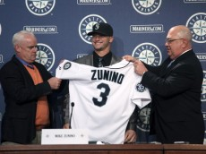 SEATTLE, WA - JULY 03:  Catcher Mike Zunino, the Seattle Mariners' first-round draft choice, is introduced to the media as Scouting Director Tom McNamara (L) and GM Jack Zduriencik look on prior to the game against the Baltimore Orioles at Safeco Field on July 3, 2012 in Seattle, Washington.(Photo by Otto Greule Jr/Getty Images)