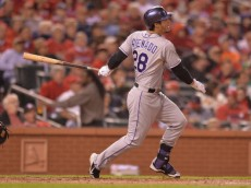ST. LOUIS, MO - SEPTEMBER 12: Nolan Arenado #28 of the Colorado Rockies hits a RBI double in the third inning against the St. Louis Cardinals at Busch Stadium on September 12, 2014 in St. Louis, Missouri.The Cardinals defeated the Rockies 5-1. (Photo by Michael B. Thomas/Getty Images)