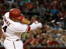 PHOENIX, AZ - APRIL 21:  Yasmany Tomas #24 of the Arizona Diamondbacks hits a second inning single against the Texas Rangers during the MLB game at Chase Field on April 21, 2015 in Phoenix, Arizona.  (Photo by Christian Petersen/Getty Images)