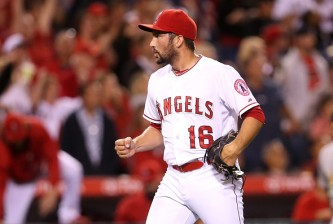 ANAHEIM, CA - JUNE 12:  Closer Huston Street #16 of the Los Angeles Angels of Anaheim reacts after getting the final out and the save against the Oakland Athletics at Angel Stadium of Anaheim on June 12, 2015 in Anaheim, California. The Angels won 5-4.  (Photo by Stephen Dunn/Getty Images)