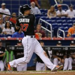 MIAMI, FL - JUNE 13:  Giancarlo Stanton #27 of the Miami Marlins hits a two RBI double during a game against the Colorado Rockies at Marlins Park on June 13, 2015 in Miami, Florida.  (Photo by Mike Ehrmann/Getty Images)