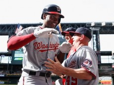 :PHOENIX, AZ - MAY 13: Michael Taylor #3 of the Washington Nationals high fives teammates in the dugout after hitting a grand-slam home-run against the Arizona Diamondbacks during the ninth inning of the MLB game at Chase Field on May 13, 2015 in Phoenix, Arizona. (Photo by Christian Petersen/Getty Images)