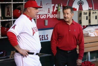 ANAHEIM, CA - APRIL 09:  Los Angeles Angels of Anaheim owner Arte Moreno (R) talks with manager Mike Scioscia prior to the start of the home opener against the Oakland Athletics at Angel Stadium of Anaheim on April 9, 2013 in Anaheim, California.  (Photo by Jeff Gross/Getty Images)