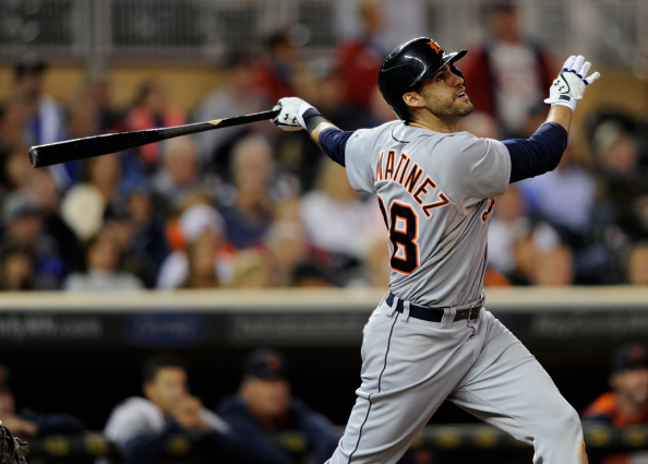 MINNEAPOLIS, MN - SEPTEMBER 16: J.D. Martinez #28 of the Detroit Tigers hits a three-run home run against the Minnesota Twins during the ninth inning of the game on September 16, 2014 at Target Field in Minneapolis, Minnesota. The Twins defeated the Tigers 4-3. (Photo by Hannah Foslien/Getty Images)