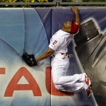 PHILADELPHIA - MAY 12: Ben Revere #2 of the Philadelphia Phillies jumps and attempts to catch a home run in the fourth inning during a game against the Pittsburgh Pirates at Citizens Bank Park on May 12, 2015 in Philadelphia, Pennsylvania. (Photo by Hunter Martin/Getty Images)