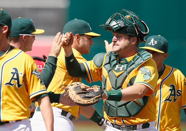 OAKLAND, CA - MAY 31:  Stephen Vogt #21 of the Oakland Athletics is congratulated by teammates after they beat the New York Yankees at O.co Coliseum on May 31, 2015 in Oakland, California.  (Photo by Ezra Shaw/Getty Images)