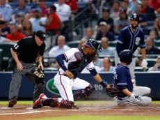 ATLANTA, GA - JUNE 09:  Second baseman Cory Spangenberg #15 of the San Diego Padres slides behind catcher Christian Bethancourt #27 of the Atlanta Braves to score in the second inning during the game at Turner Field on June 9, 2015 in Atlanta, Georgia.  (Photo by Mike Zarrilli/Getty Images)