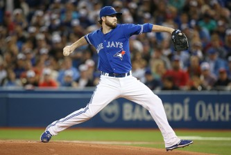 TORONTO, CANADA - JUNE 28: Drew Hutchison #36 of the Toronto Blue Jays delivers a pitch in the first inning during MLB game action against the Texas Rangers on June 28, 2015 at Rogers Centre in Toronto, Ontario, Canada. (Photo by Tom Szczerbowski/Getty Images)