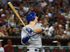 PHOENIX, AZ - JUNE 29:  Joc Pederson #31 of the Los Angeles Dodgers follows through on a swing after hitting a fourth inning home run against the Arizona Diamondbacks at Chase Field on June 29, 2015 in Phoenix, Arizona.  (Photo by Norm Hall/Getty Images)