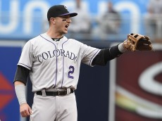 SAN DIEGO, CA - JULY 18:  Troy Tulowitzki #2 of the Colorado Rockies yells after turning a double play during the first inning of a baseball game against the San Diego Padres at Petco Park July 18, 2015 in San Diego, California.  (Photo by Denis Poroy/Getty Images)