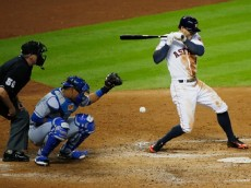 :HOUSTON, TX - JULY 01: George Springer #4 of the Houston Astros gets hit by a pitch in the fifth inning during their game against the Kansas City Royals at Minute Maid Park on July 1, 2015 in Houston, Texas. (Photo by Scott Halleran/Getty Images)