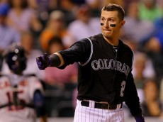 DENVER, CO - JUNE 17:  Troy Tulowitzki #2 of the Colorado Rockies tosses his helmet after striking out to end the eighth inning against the Houston Astros during Interleague play at Coors Field on June 17, 2015 in Denver, Colorado. (Photo by Justin Edmonds/Getty Images) *** Local Caption *** Troy Tulowitzki