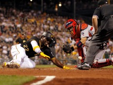 PITTSBURGH, PA - MAY 08:  Andrew McCutchen #22 of the Pittsburgh Pirates slides in safe against Yadier Molina #4 of the St. Louis Cardinals on a force out at second in the sixth inning during the game at PNC Park on May 8, 2015 in Pittsburgh, Pennsylvania.  (Photo by Justin K. Aller/Getty Images)