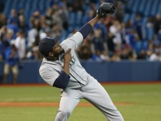 TORONTO, CANADA - MAY 22: Fernando Rodney #56 of the Seattle Mariners celebrates his save after getting the final out of the ninth inning during MLB game action against the Toronto Blue Jays on May 22, 2015 at Rogers Centre in Toronto, Ontario, Canada. (Photo by Tom Szczerbowski/Getty Images)