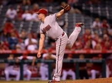 ANAHEIM, CA - JUNE 15:  Addison Reed #43 of the Arizona Diamondbacks follows through on a pitch in the ninth inning on his way to picking up the save against the Los Angeles Angels of Anaheim at Angel Stadium of Anaheim on June 15, 2015 in Anaheim, California.  The Diamondbacks won 7-3.  (Photo by Stephen Dunn/Getty Images)