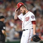WASHINGTON, DC - AUGUST 07:  Drew Storen #22 of the Washington Nationals walks back to the dug out after giving a grand slam to Carlos Gonzalez #5 (not pictured) of the Colorado Rockies during a baseball at Nationals Park on August 7, 2015 in Washington, DC.  (Photo by Mitchell Layton/Getty Images)