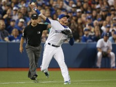 TORONTO, CANADA - AUGUST 14: Josh Donaldson #20 of the Toronto Blue Jays makes a throwing error in the third inning during MLB game action against the New York Yankees on August 14, 2015 at Rogers Centre in Toronto, Ontario, Canada. (Photo by Tom Szczerbowski/Getty Images) *** Local Caption *** Josh Donaldson