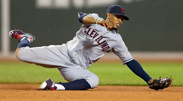 BOSTON, MA - AUGUST 18:  Francisco Lindor #12 of the Cleveland Indians makes a diving grab but fails to throw out Rusney Castillo #38 of the Boston Red Sox for the out allowing a run to score  in the fifth inning at Fenway Park on August 18, 2015 in Boston, Massachusetts.  (Photo by Jim Rogash/Getty Images)