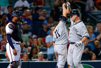 ATLANTA, GA - AUGUST 28:  Brian McCann #34 of the New York Yankees reacts with Brett Gardner #11 after hitting a three-run homer in the eighth inning against the Atlanta Braves at Turner Field on August 28, 2015 in Atlanta, Georgia.  (Photo by Kevin C. Cox/Getty Images)