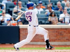 NEW YORK, NY - AUGUST 30:  Michael Cuddyer #23 of the New York Mets follows through on a seventh inning RBI base hit against the Boston Red Sox at Citi Field on August 30, 2015 in the Flushing neighborhood of the Queens borough of New York City.  (Photo by Jim McIsaac/Getty Images)